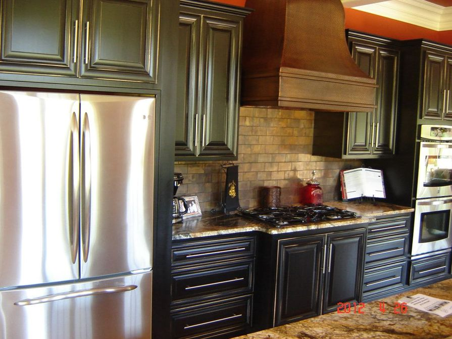 Black solid wood kitchen.distressed finish.granite counters.