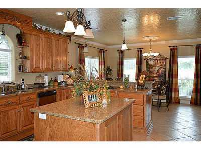 Solid Oak kitchen cabinets.granite counter tops.custom solid wood